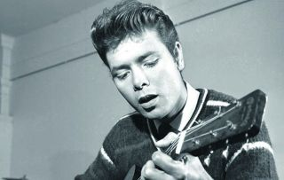 Cliff Richard in 1962 playing the guitar. Watch The Cliff Richard Story on Friday 25th May
