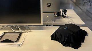 Unrelease Vive VR headset under a black sheet in an office