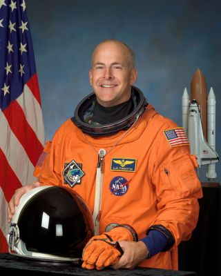 A portrait of NASA astronaut Alan G. Poindexter, veteran space shuttle pilot and commander.