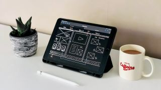 Best wireframe tools: Wireframe shown on tablet, next to a coffee cup and plant