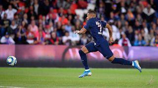PARIS, FRANCE - AUGUST 11: Kylian Mbappe of Paris Saint-Germain runs with the ball during the Ligue 1 match between Paris Saint-Germain and Nimes Olympique at Parc des Princes on August 11, 2019 in Paris, France