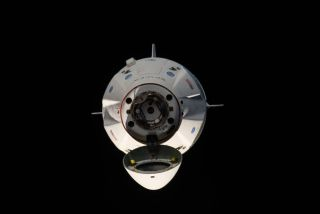 SpaceX's Crew Dragon spacecraft approaches the International Space Station on March 3, 2019, on the capsule's uncrewed Demo-1 mission.