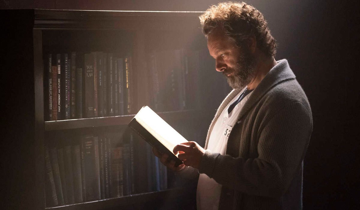 Michael Sheen reading a book from jail.