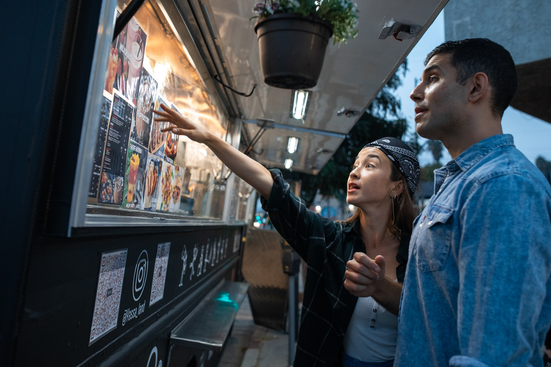 Two people paying at food truck