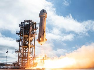 Blue Origin's New Shepard suborbital vehicle launches on an uncrewed mission in December 2019. The company's next New Shepard flight is targeted for Aug. 25, 2021.