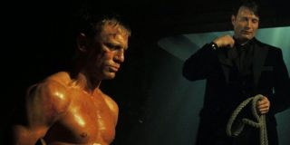 Casino Royale Daniel Craig about to be whipped by Mads Mikkelsen