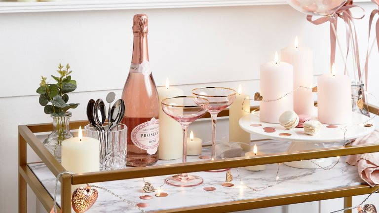 Valentine's Day must haves: Lights4Fun image of bar cart with drinks on and fairy lights