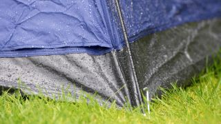A tent with water droplets running off it