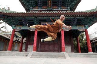 Trainee Monk Yandian practises Kung Fu at the Shaolin Temple, China