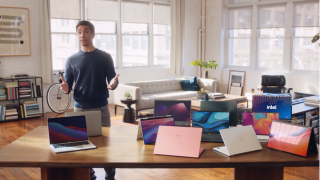 Actor Justin Long in front of Macs and Intel Laptops