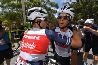 Richie Porte celebrates his overall win waith a teammate