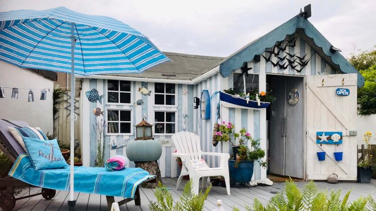 Cuprinol shed of the year: A shed painted with light blue and white stripes