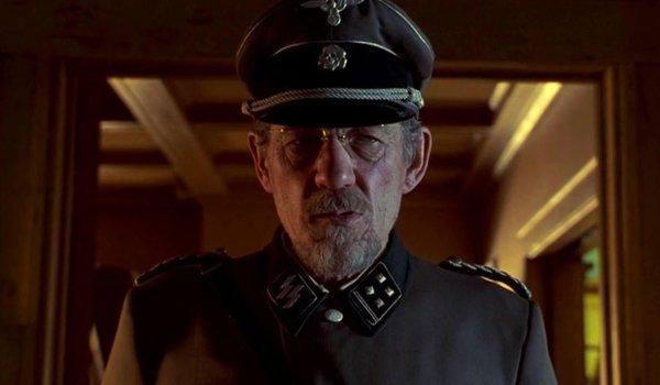 Apt Pupil Ian McKellen dressed in a Nazi uniform, glaring with evil