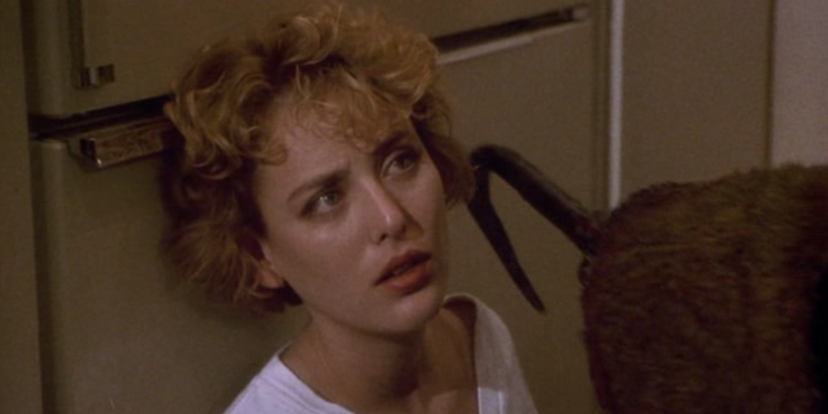 Virginia Madsen as Helen Lyle and Candyman in the 1992 movie