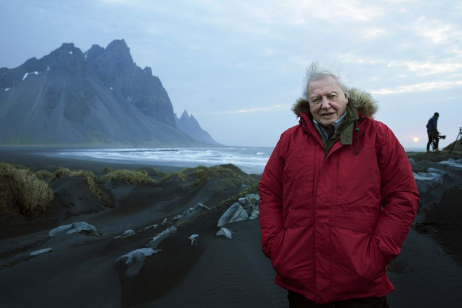 David Attenborough in red parka