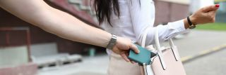 Smartphone being stolen out of woman's purse