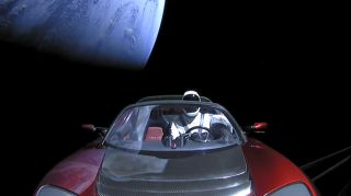 A screengrab from the SpaceX live feed shows the Roadster leaving Earth behind.