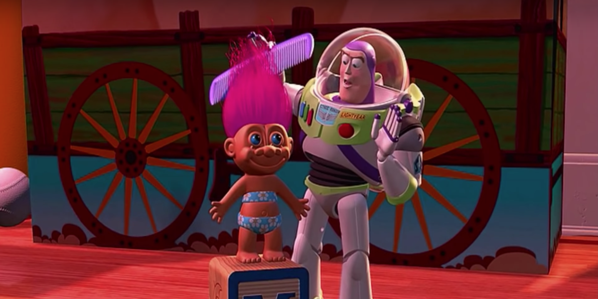 Buzz Lightyear brushing Troll's hair
