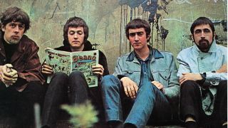 The 20 greatest british blues albums 1960 1966 louder john mayalls bluesbreakers with eric clapton sitting against a wall clapton reading the beano malvernweather Images