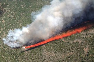 An MD-87 tanker fights a forest fire