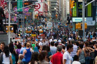 a crowded New York City street near Broadway