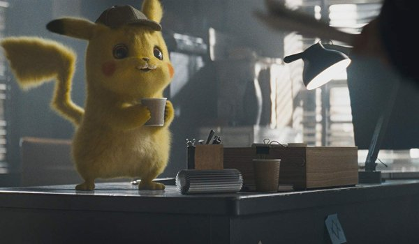 Detective Pikachu enjoying a cup of coffee standing on Harry's desk