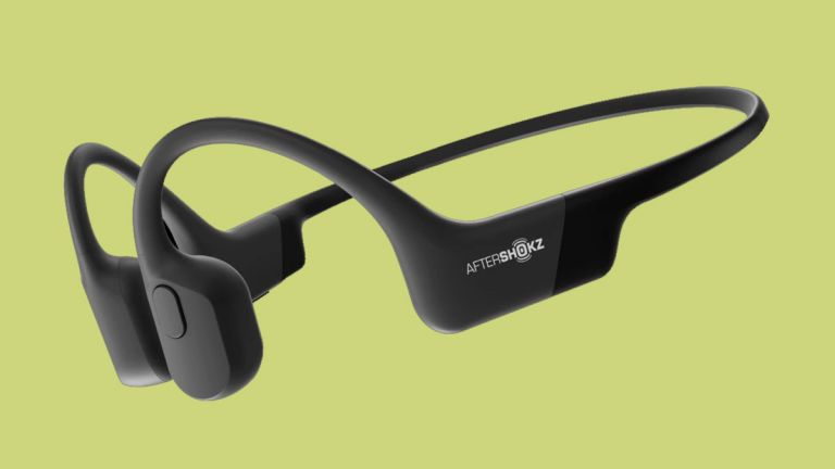 The AfterShokz Aeropex headphones on a green background