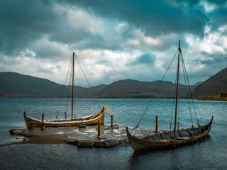 two docked viking boats