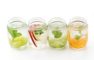 Glasses of water infused with fruit.