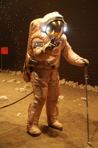 Mars500 astronaut Diego Urbina treks across simulated Martian terrain. Urbina is carrying a tool originally designed for Soviet manned lunar missions in the 1960s and 1970s that never came to pass.