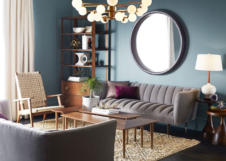 living room with large circle mirror