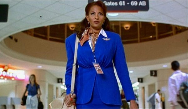 Jackie Brown walking through the airport, in her uniform