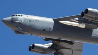A June 12, 2019 photo shows a B-52 carrying an ARRW prototype (in white, under the left wing) during a test where it was not launched.