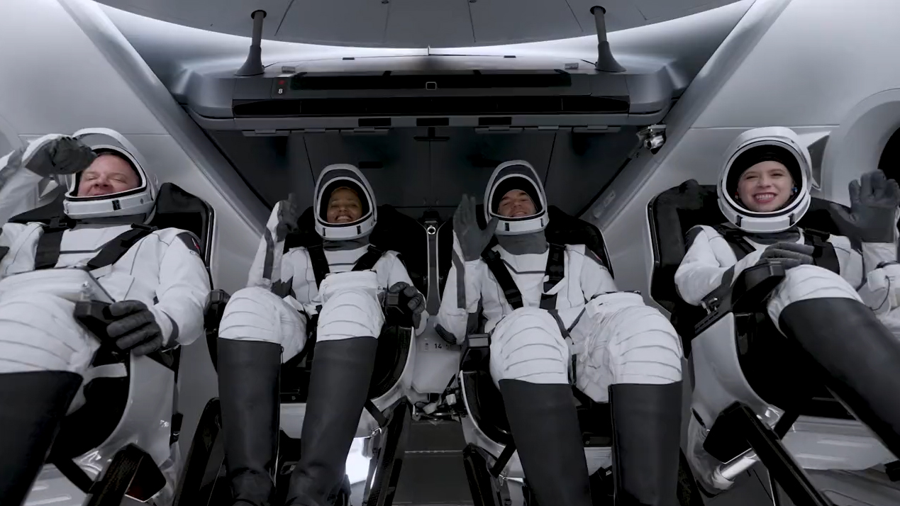 The four Inspiration4 astronauts wave and give thumb's up signs to the camera inside SpaceX's Crew Dragon Resilience as they await launch atop NASA's Pad 39A at the Kennedy Space Center in Florida on Sept. 15, 2021. They are (from left): Chris Sembroski, Sian Proctor, Jared Isaacman and Hayley Arceneaux.