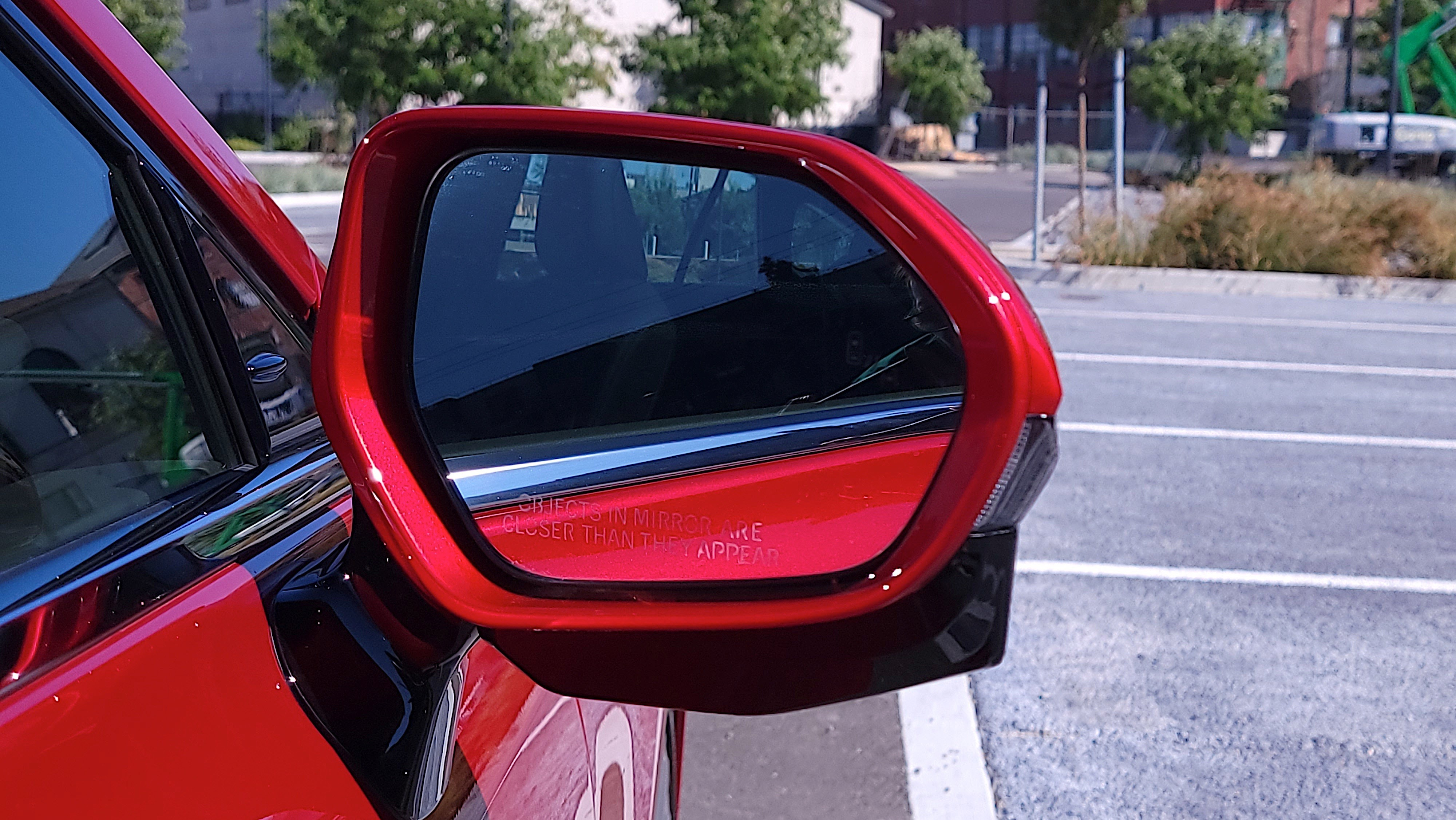 Close-up view of the front of a Toyota Mirai (2021) side mirror