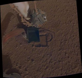 "Scientists with NASA's InSight Mars lander mission recently got the spacecraft's burrowing heat probe moving again after ""pinning"" it with the lander's soil scoop."