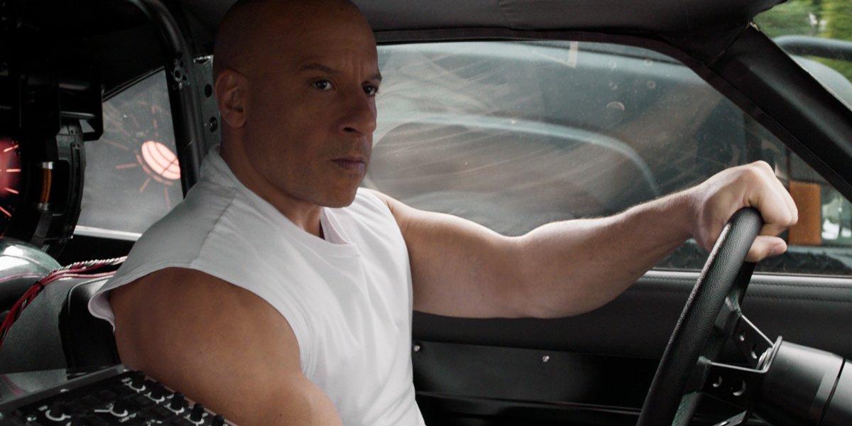 Vin Diesel looks determined behind the wheel in F9.