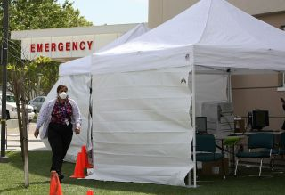 A nurse walking by a triage tent set up outside of the emergency room at Sutter Delta Medical Center in Antioch, California on April 30, 2009. The hospital was preparing for a potential flood of patients worried they might have swine flu.