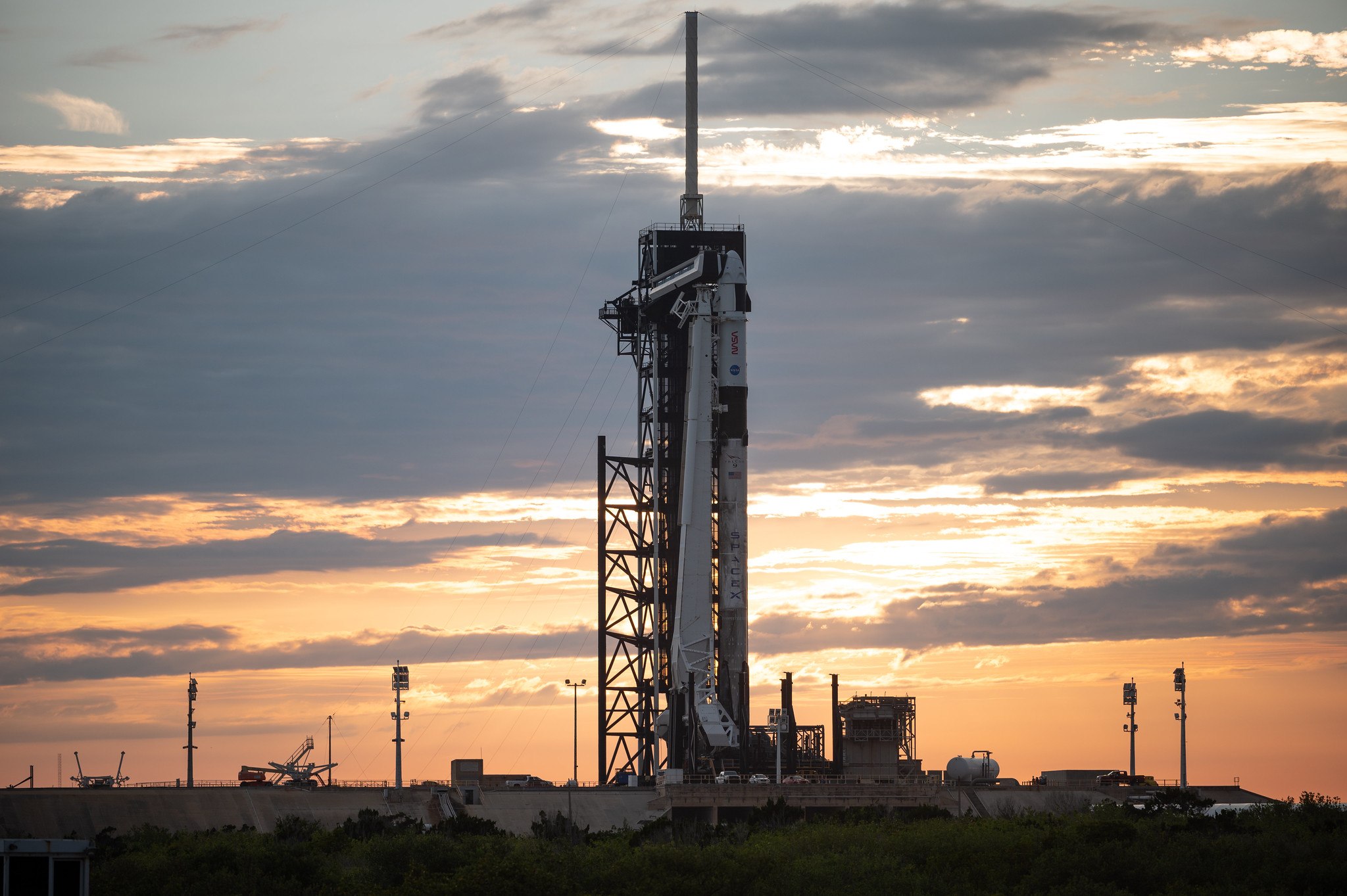 A SpaceX Falcon 9 rocket and Crew Dragon spacecraft are seen at sunset on the launch pad at Launch Complex 39A as preparations continue for the Crew-2 mission, on April 19, 2021, at NASA's Kennedy Space Center in Florida.
