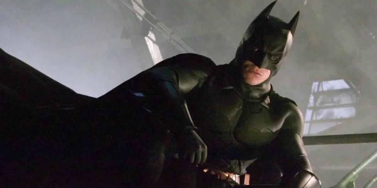 Christian Bale looks over Gotham in Batman Begins