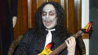Metallica's Kirk Hammett dressed as a vampire