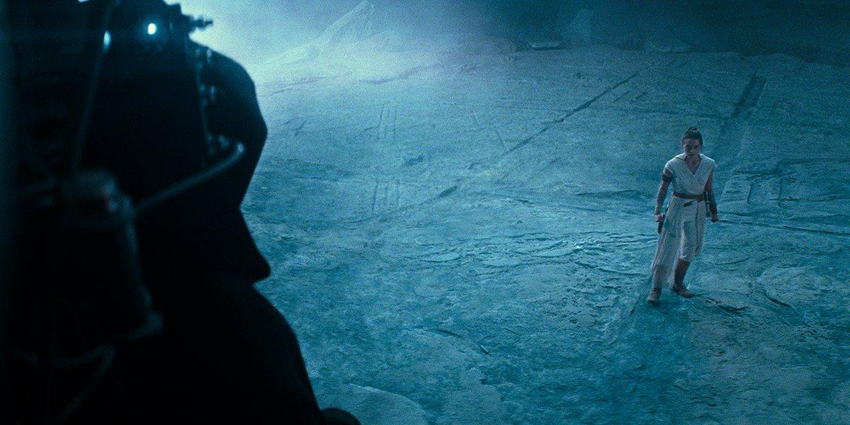 Emperor Palpatine looming over Rey