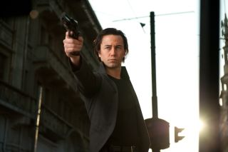 "Joseph Gordon-Levitt Brandishing a Gun in ""Looper"""