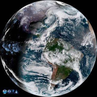 A view of Earth, half in darkness, with a powerful white spiral storm heading over the U.S. East Coast.