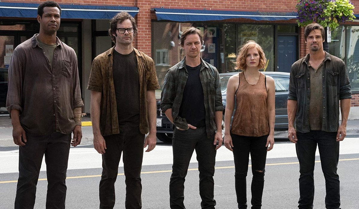 IT Chapter Two The Losers Club survivors standing in the streets of Derry