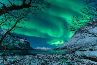 The aurora shimmered in the night sky over Tromsø, Norway, on Jan. 9, 2014, after a coronal mass ejection arrived in near-Earth space, following a two-day journey from the sun.