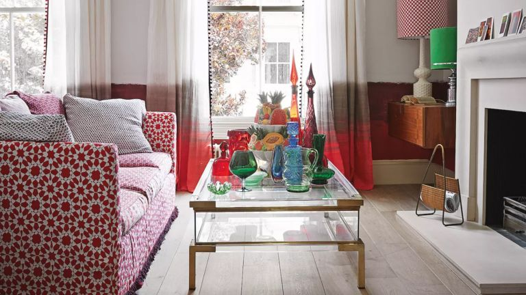 Red and white living room with patterned sofa