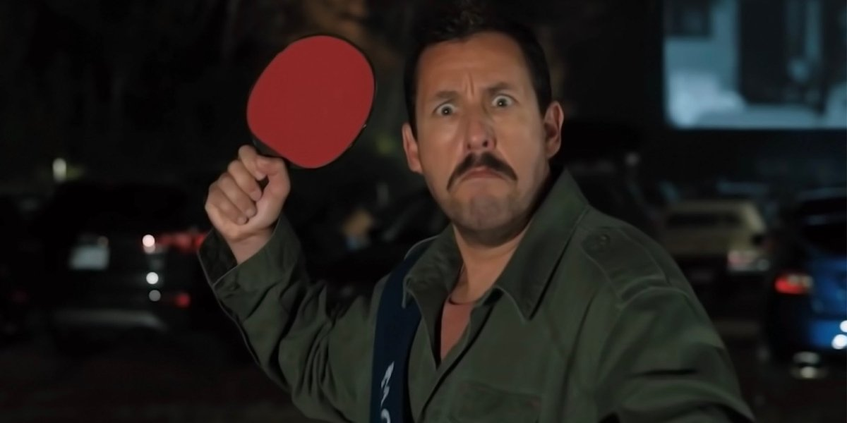 Hubie Halloween Adam Sandler holding a defensive ping pong paddle