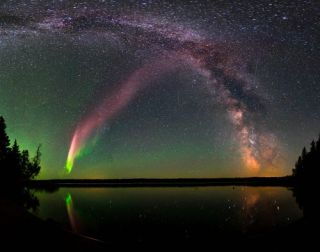 This composite image shows STEVE alongside the Milky Way over Childs Lake, Manitoba, Canada.