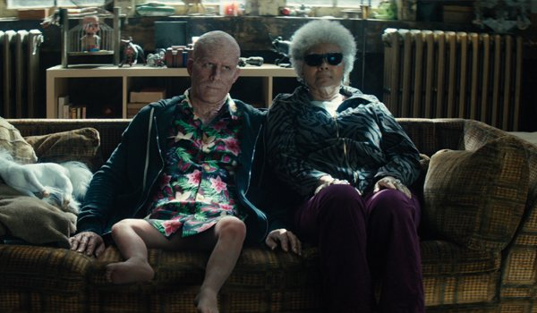 Deadpool 2 Wade Wilson with baby legs and Blind Al hang out on the couch